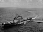 USS Saratoga underway with SBD Dauntless, F6F Hellcat, and TBF Avenger aircraft on her flight deck, 1943-1944