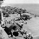 F6F-3 Hellcat, TBF-1 Avenger, and SBD-5 Dauntless aircraft aboard USS Saratoga in the Gilbert Islands, Nov 1943