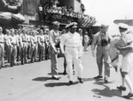 British Royal Navy Rear Admiral Clement Moody visiting US carrier USS Saratoga, 27 Mar 1944