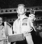 US Navy pilot Commander Joseph Clifton celebrating a successful raid on Rabaul, New Britain aboard USS Saratoga, 5 Nov 1943