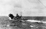 Scharnhorst firing her forward guns against HMS Glorious, in the Norwegian Sea west of Narvik, Norway, 8 Jun 1940