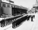 Crew of USS Segundo being inspected during change of command ceremony, Mare Island Naval Shipyard, California, United States, 6 Jul 1953