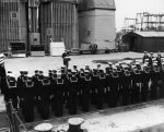 Crew of USS Segundo hearing an address during her change of command at Mare Island Naval Shipyard, California, United States, 18 Oct 1955