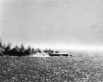 Shoho burning during Battle of Coral Sea, photographed by a torpedo bomber pilot from Yorktown, 7 May 1942