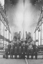 The chief shipbuilders of carrier Shokaku posing with the hull of the ship two days prior to launching, Yokosuka, Japan, 30 May 1939