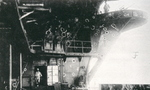 View of damage done to boat deck area aboard Shokaku, result of the second bomb hit received during Battle of the Coral Sea, Kure, Japan, between 17 May and 27 Jun 1942, photo 1 of 2