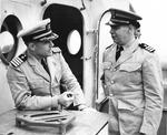 USCG Cmdr Harold S. Berdine of cutter Spencer talking with US Navy Capt Paul Heineman of the Escort Group A-3 after sinking German submarine U-175, North Atlantic, 500 nautical miles WSW of Ireland, 17 Apr 1943