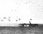 USS Steamer Bay under attack near the Philippine Islands, 5 Jan 1945; note special attack aircraft flying past her stern