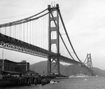 Tennessee-class battleship entering San Francisco Bay under the nearly completed Golden Gate Bridge on her way to attend the opening of the Oakland Bay Bridge, California, United States, 12 Nov 1936