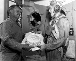 Captain Dixie Kiefer of USS Ticonderoga presenting VT-80 pilot Clyde Grow a cake for making the 6,000th landing on the carrier (