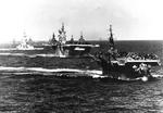 US Navy Task Group 38.3 entering Ulithi anchorage in a column following strikes in Philippine Islands, 24 Dec 1944, photo 4 of 7
