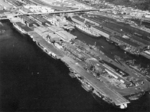 USS Bunker Hill, USS Bon Homme Richard, USS Essex, USS Ticonderoga, USS Indiana, and USS Alabama at Pier 92, Seattle, Washington, United States, 9 Jan 1947