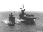 Ammunition ship USS Mount Baker replenishing carrier USS Ticonderoga, off California, United States, 2 Sep 1965