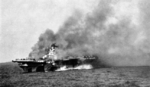 USS Ticonderoga burning after being hit by two special attack aircraft, 125 miles east-southeast of Taiwan, 21 Jan 1945
