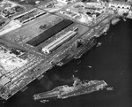 USS Ticonderoga, USS Kitty Hawk, and USS Constellation at Naval Air Station North Island, San Diego, California, United States, circa mid-1970