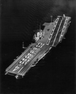 Crew of USS Ticonderoga spelling out SEAFAIR 62 on the flight deck, 29 Jul 1962