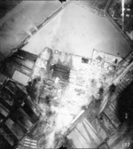 Kaneka Soda Company chemical plant under attack by Air Group 80 aircraft from USS Ticonderoga, Tainan, Taiwan, 15 Jan 1945, photo 1 of 2