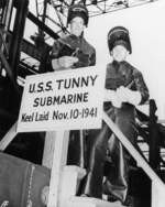 W. N. Simons and Robert F. Cooke, honorary keel layers of submarine Tunny, posing with the sign at Mare Island Naval Shipyard, California, United States, 10 Nov 1941