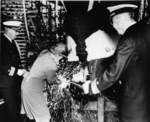 Mrs. Frederick Crisp christening submarine Tunny, Mare Island Naval Shipyard, Vallejo, California, United States, 30 Jun 1942; Commander Lemuel Padget and Rear Admiral W. L. Friedell were also present