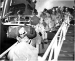 Japanese-American members of US 442nd Regimental Combat Team walking down the gangplank of Victory Ship USS Waterbury Victory, Honolulu, US Territory of Hawaii, 9 Aug 1946, photo 1 of 2
