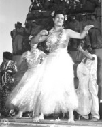 Hula dancers entertain returning Japanese-American veterans of US 442nd Regimental Combat Team aboard Victory Ship USS Waterbury Victory, Honolulu, US Territory of Hawaii, 9 Aug 1946; photo 1 of 7