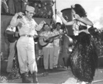 Hula dancers entertain returning Japanese-American veterans of US 442nd Regimental Combat Team aboard Victory Ship USS Waterbury Victory, Honolulu, US Territory of Hawaii, 9 Aug 1946; photo 3 of 7