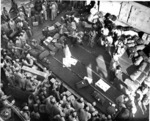 Hula dancers entertain returning Japanese-American veterans of US 442nd Regimental Combat Team aboard Victory Ship USS Waterbury Victory, Honolulu, US Territory of Hawaii, 9 Aug 1946; photo 4 of 7