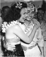 Hula dancers entertain returning Japanese-American veterans of US 442nd Regimental Combat Team aboard Victory Ship USS Waterbury Victory, Honolulu, US Territory of Hawaii, 9 Aug 1946; photo 5 of 7