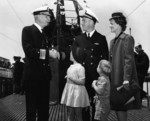 Rear Admiral W. L. Friedell greeting Lieutenant Commander Richard O
