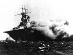 Wasp (Wasp-class) burning and listing after being torpedoed by Japanese submarine I-19 in the South Pacific, 15 Sep 1942. Photo 1 of 2.