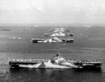 USS Wasp, USS Yorktown, USS Hornet, USS Hancock, USS Ticonderoga, and other warships at Ulithi Atoll, Caroline Islands, 8 Dec 1944, photo 2 of 3