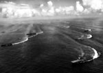USS Wasp (lower right) and other Essex-class carriers, escorted by battleships, cruisers, and destroyers of Task Force 38 maneuvering off Japan, 17 Aug 1945