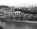 USS Ballard at Mare Island Navy Yard, Vallejo, California, United States, 5 Jan 1942; note submarines under construction, probably Wahoo and Whale