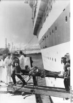 Two medics unloading a wounded German soldier from hospital ship Wilhelm Gustloff, Jul 1940
