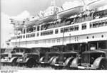 Ambulances lined up ready to take on wounded soldiers from hospital ship Wilhelm Gustloff, Jul 1940, photo 1 of 2