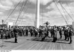 The Oslo, Norway police orchestra playing music for the wounded soldiers aboard hospital ship Wilhelm Gustloff, 1940, photo 2 of 2