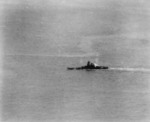 Yamato listing but still underway, 7 Apr 1945