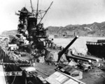 Battleship Yamato fitting out, Kure Naval Arsenal, Japan, Sep 1941; light carrier Hosho at extreme right