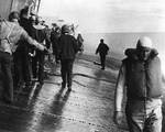 Crew of Yorktown struggled to maintain balance as the ship listed, 4 Jun 1942