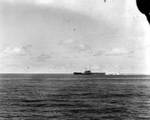 A Type 99 dive bomber attacked Yorktown, seen from cruiser Astoria, 4 Jun 1942