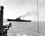 Yorktown stopped after receiving bombs, seen from cruiser Astoria, just after 1200, 4 Jun 1942