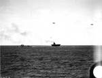 Yorktown dead in the water, escorted by destroyer Russell, 1330, 4 Jun 1942; two SBD-3 scout bombers flew overhead