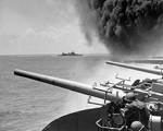 Starboard side guns of Yorktown ready to fire, 4 Jun 1942; note the smoke rising from the carrier; cruiser Astoria in background