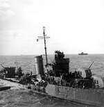 Destroyer Benham with 720 survivors of Yorktown on board, at 1900 on 4 Jun 1942; Yorktown in the distance