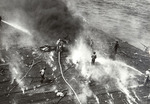 Crew of USS Yorktown fighting a fire during the Battle of Midway, 4 Jun 1942