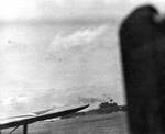 Yorktown under attack by dive bombers, seen from cruiser Portland, 4 Jun 1942