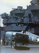 F6F-3 Hellcat fighter being prepared for launch aboard USS Yorktown during the carrier