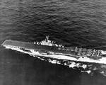 Essex-class carrier Yorktown underway in the Mariana Islands, Jun 1944; note camouflage Measure 33, Design 10a; also F6F Hellcat fighters, TBF Avenger torpedo bombers, and SB2C Helldiver dive bombers