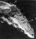 Carrier Zuiho damaged during Battle off Cape Engaño, 25 Oct 1944; note battleship camouflage; as seen on page 68 of US Navy War Photographs
