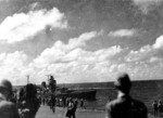 Vice Admiral Jisaburo Ozawa transferring his flag from damaged carrier Zuikaku to light cruiser Oyodo, at 1100 hours on 25 Oct 1944